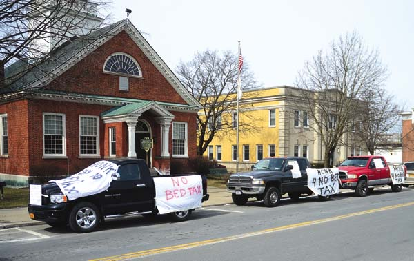 """Protestors draped their vehicles in """"No Bed Tax"""" signs along North William Street in Johnstown on Monday. The """"bed tax""""passed anyway. (The Leader-Herald/Bill Trojan)"""