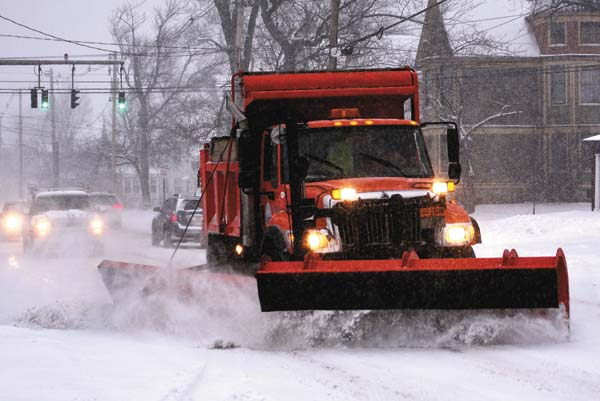 A Johnstown Department of Public Works truck plows North Perry Street in Johnstown this morning. (The Leader-Herald/Bill Trojan)