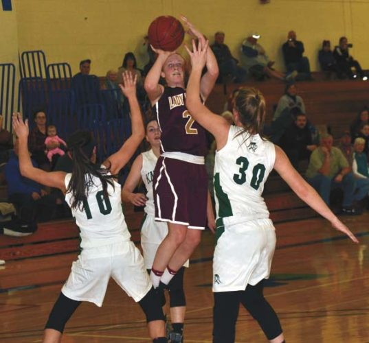 Fonda-Fultonville's Julianna Taylor (2) shoots over Middleburgh's Lyndsey McCoy (10) and Kelsey Campbell (30) during a Western Athletic Conference crossover game at Fulton-Montgomery Community College on Feb. 14. Taylor and McCoy recently were named a first-team Western Athletic Conference Hudson Division all-stars. (The Leader-Herald/Paul Wager)