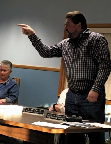 Town of Johnstown Highway Superintendent T.J. Bradt points at board member Tim Rizzo during a heated exchange Monday night over the leasing of tractors. (The Leader-Herald/Jason Subik)