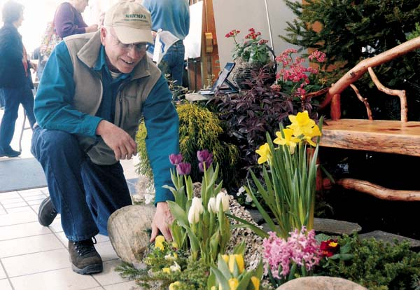 Marty Krempa, owner of Krempa Custom Landscaping & Design of Johnstown works on his display during the Fulton County Home Show and Craft Fair at Broadalbin-Perth High School on March 21, 2015. The show returns this year for the eighth year. (The Leader-Herald/Bill Trojan)