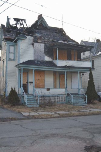 The property at 14 Temple St. is shown March 9, 2016. The building was damaged by a July 3, 2014 fire caused by lightning.  (The Leader-Herald/Kerry Minor)