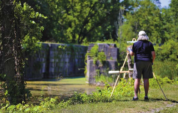 Local painter Deborah Angilletta plein air painting at Empire Lock as Schoharie Crossing in July of 2016. (Photo courtesy of Halldor Sigurdsson)