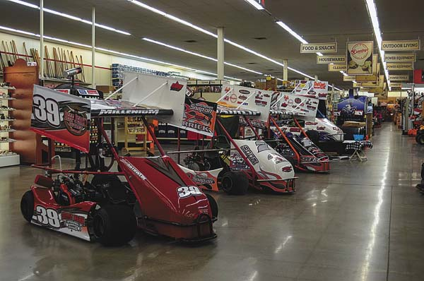 Karts line the main aisle at the inaugural go-kart show featuring members of the Wing Cart Racing Series on Saturday at Runnings in Gloversville. The show continues today during store hours. (The Leader-Herald/James A. Ellis)