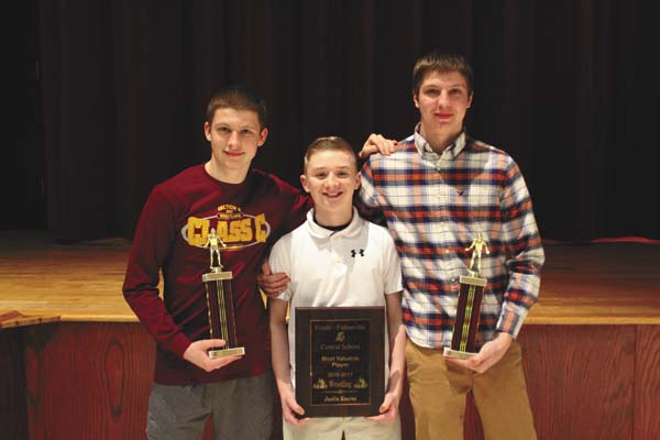 Photo submitted From left, Clane Newcomer (most improved), Justin Kearns (MVP) and Kyle Gray (Coach's Award) were the award winners for the Fonda-Fultonville varsity wrestling team. Not pictured is Nate Rose (most team points, fastest pin).
