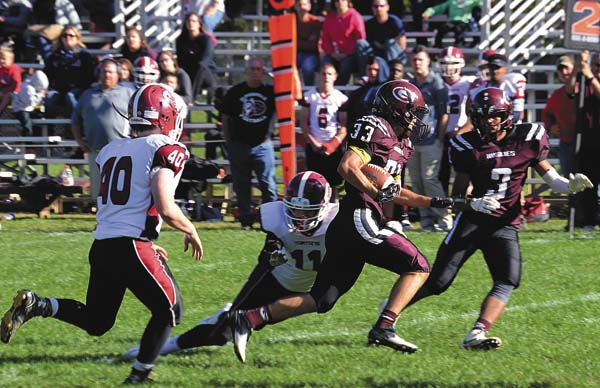 Gloversville's Jackson Peck (33) carries the ball for a big gain during a Class A Northwest Division game against Scotia-Glenville on Sept. 24 at Husky Field in Gloversville. The Huskies are scheduled to host Scotia-Glenville in a Week 7 matchup next fall. (The Leader-Herald/James A. Ellis)