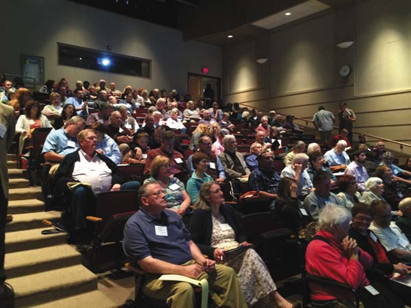Participants of last year's lecture and tour series listen during one of the presentations. (Photo submitted)