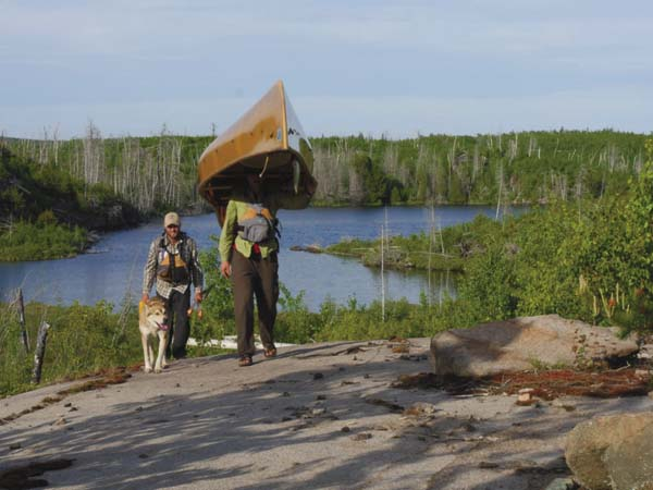 """Photo submitted Dave and Amy Freeman walk along Minnesota's Boundary Waters for the film, """"Bear Witness."""" The film will be featured at the Reel Paddling Film Festival in Lake Placid. (Photo submitted)"""