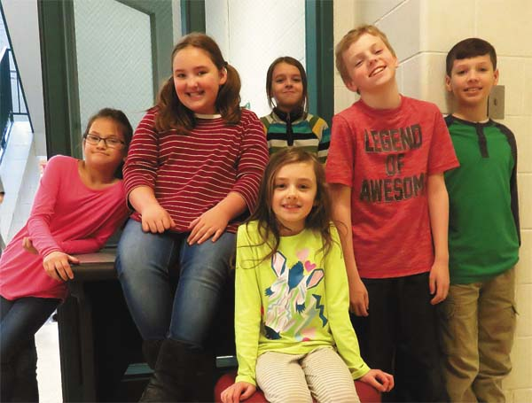 From left are Northville Central School poster  contest entrants  Isabella Pepper, Victoria Ladmer, Lily Moules (back), Leanora Fitzgerald (seated in front), Landon Lent and James Pertell. They won a Flame concert for their school. (Photo submitted)
