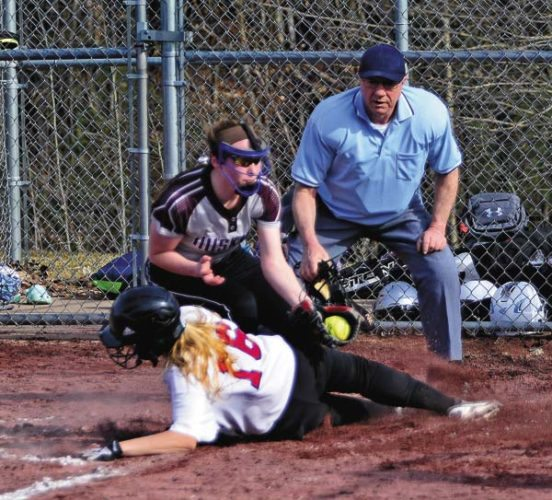 Gloversville's Jennifer Vickery, left, tags Broadalbin-Perth's Ali Visco at the plate during Monday's Foothills Council game. (The Leader-Herald/Bill Trojan)