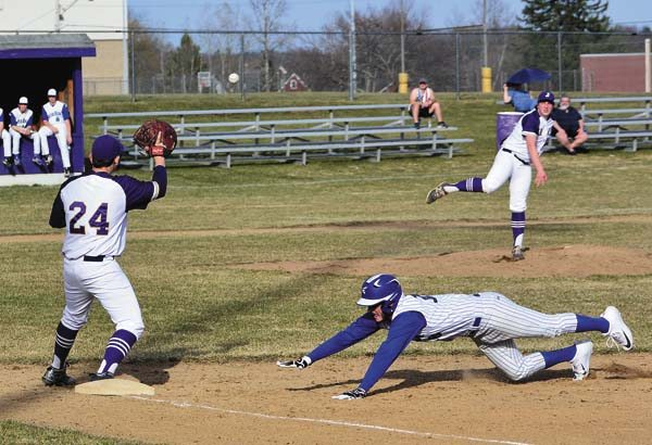 South Glens Falls' Brendan Yando, right, dives back to first on a pickoff attempt by Johnstown's Ben Wager as first baseman Derek Lee awaits the throw during Monday's Foothills Council game. (The Leader-Herald/Bill Trojan)