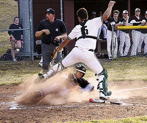Gloversville's Tyler Quinones slides under Hudson Falls catcher Raven Carlisle after he missed a high throw on Dylan Sweeney's fourth-inning squeeze bunt to score what proved to be the winning run in Monday's Foothills Council game at Husky Field. (The Leader-Herald/James A. Ellis)