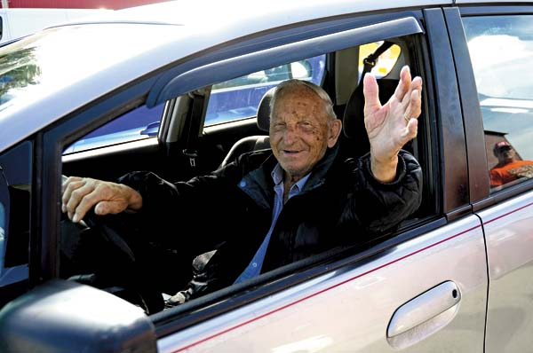 Mel Rulison of Gloversville waves from his vehicle prior to his retirement party at the Leader-Herald offices Monday. (The Leader-Herald/Bill Trojan)