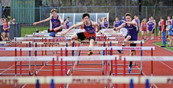 From left, Broadalbin-Perth's Jonathon Simmons, Broadalbin-Perth's Christopher Wagner and Johnstown's Erik Frank compete in the boys 110-meter hurdles during Tuesday's Foothills Council meet at Patriot Field inBroadalbin. (The Leader-Herald/Bill Trojan)