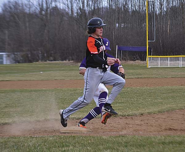 Johnstown pitcher Mike Brown, back, touches first to force out Schuylerville's Cameron Alber during TuesdayÕs Foothills Council game at Johnstown High School. (The Leader-Herald/Paul Wager)