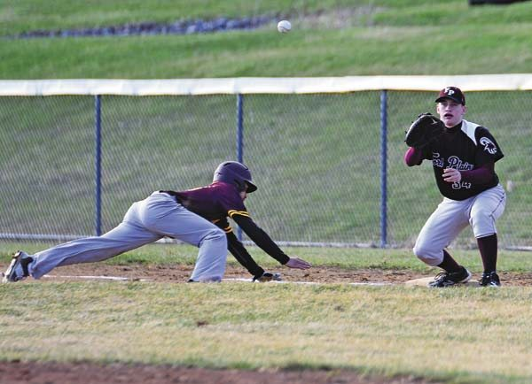 Fonda-Fultonville's Jackson Simpson, left, dives back to first base as Fort Plain's Bryce Thibodeau awaits the throw during WednesdayÕs Western Athletic Conference game. (The Leader-Herald/Bill Trojan)