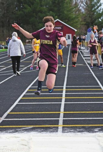 Fonda-Fultonville's Giuliana Capparello takes off from the board in the long jump competition at Thursday's Western Athletic Conference meet at Fonda-Fultonville High School.  (The Leader-Herald/Bill Trojan)