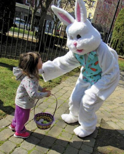 Sophia Watkins, 2, of Johnstown greets the Easter bunny during the annual Twin Cities Council of Churches egg hunt in Main Street park in Johnstown. (The Leader-Herald/Eric Retzlaff)