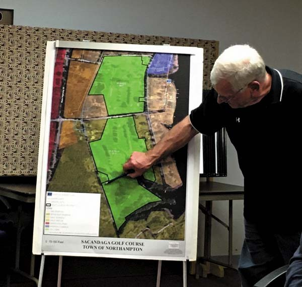 Northhampton Town Councilman William Gritsavage points to a map showing the plan to subdivide the Sacandaga Golf Course. (The Leader-Herald/Jason Subik)