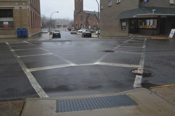 The crosswalk at the intersection of North Main Street and Church Street is shown on Friday. Downtown specialist Jennifer Jennings is proposing the use of creative crosswalks to get drivers to slow down and to spark interest in spending time, and money, downtown Gloversville.  (The Leader-Herald/Kerry Minor)