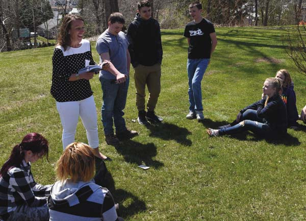 HFM Ag P-TECH teacher Julia Hudyncia works with students outside April 13. (Photo submitted)