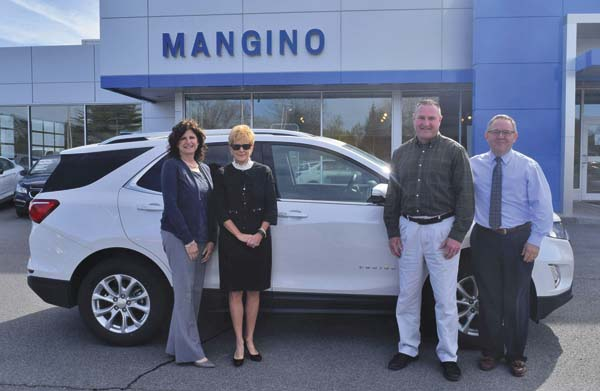 Pictured from left, Tina Mangino-Coffey, president, Mangino Chevrolet; Lesley Lanzi, FM Foundation chief advancement officer and executive director; Gregg Roth, director of FMÕs information technology department and golf committee co-chair; and, Dave Groesbeck, general manager of Mangino Chevrolet standing in front of a 2018 Chevrolet Equinox, this yearÕs featured hole-in-one vehicle at FMÕs annual golf tournament. (Photo submitted)