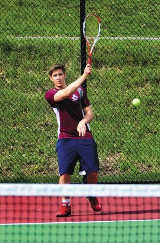 Gloversville's Nicholas Bruce hits a forehand during Wednesday's Foothills Council match against HudsonFalls at Knox Field inJohnstown. (The Leader-Herald/Bill Trojan)