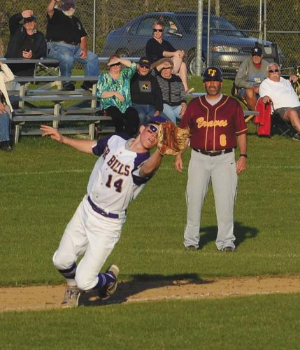 Johnstown third baseman Trevor Porter stretches to make the catch on a fly ball off the bat of Fonda-Fultonville'[s Massimo DiCaprio during non-league action Thursday at Johnstown High School. (The Leader-Herald/James A. Ellis)