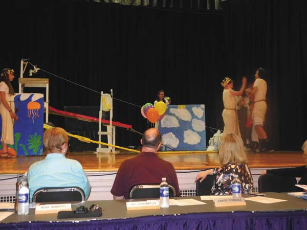 Members of the Greater Johnstown School District Board of Education watch an Odyssey of the Mind performance Wednesday night at Knox Junior High School. (The Leader-Herald/Michael Anich)