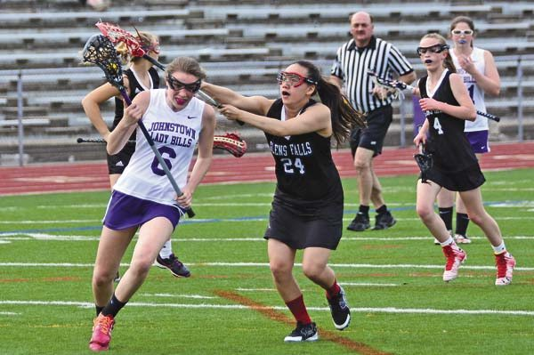 Johnstown's Amber Tesi (6) controls the ball as Glens Falls' Mia Cote defends during Friday's Foothills Council girls lacrosse game at Knox Field. (The Leader-Herald/Bill Trojan)