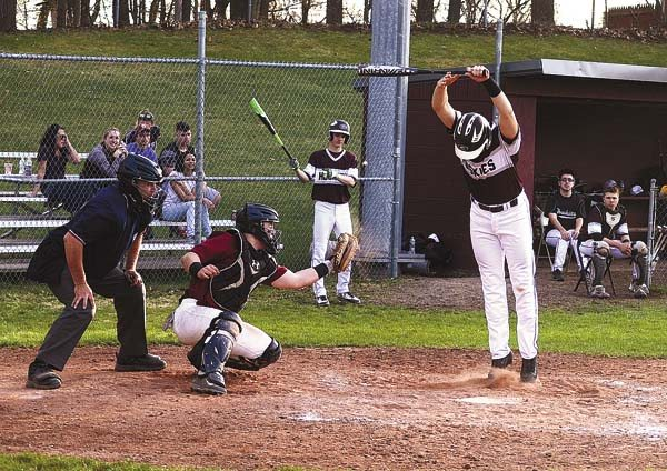 Gloversville's Trevor Mee jumps out of the way as Scotia-Glenville cacher Isaac Puglisi catches an inside pitch during the seventh inning of Friday's Foothills Council South Division game at Husky Field. (The Leader-Herald/James A. Ellis)