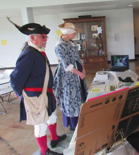 Lisa Emden of Ephratah and Robert Metzger of Johnstown stand in colonial garb as two of the representatives of an exhibit of historic Fort Klock in St. Johnsville. The exhibit was part of the Arkell Museum's community day Saturday. (The Leader-Herald/Eric Retzlaff)