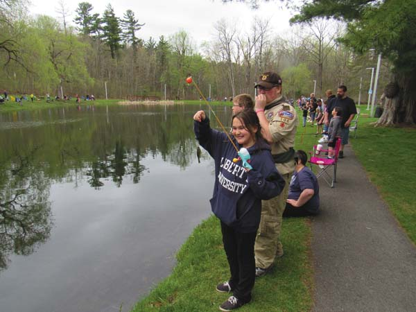 Aleena Cross, 10, of Gloversville is excited to catch even a small fish. (The Leader-Herald/Eric Retzlaff)