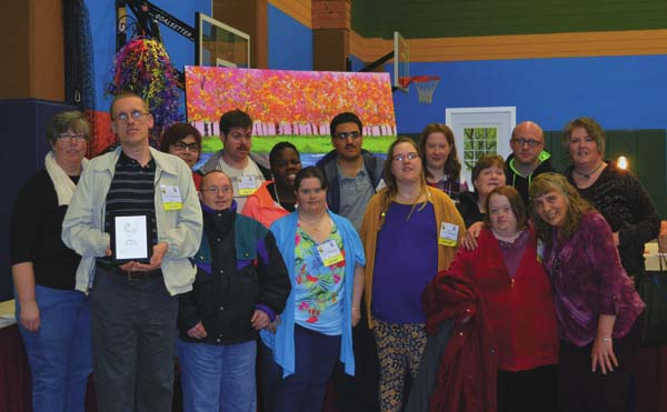 From left, Lisa Thatcher (art instructor), Mark Klug (holding the award), Nicole Lyons, Andy Hall, Justin Schram, Adobi Woods, Frank Rivera, Breauna Theobald, Samantha Togaila, Bethany Cramer, Dorothy Cool, Nicole Bellamy, Anthony Battisti, Sue Jones (art instructor), and Amy Devendorf (art director). (Photo submitted)