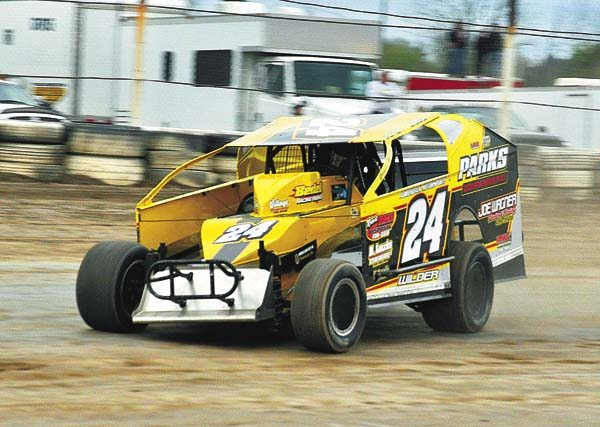 Jeremy Wilder powers his way through turns three and four en route to winning his heat race Saturday night at Fonda Speedway. Wilder notched his first win of the season in the 30-lap modified feature. (The Leader-Herald/James A. Ellis)