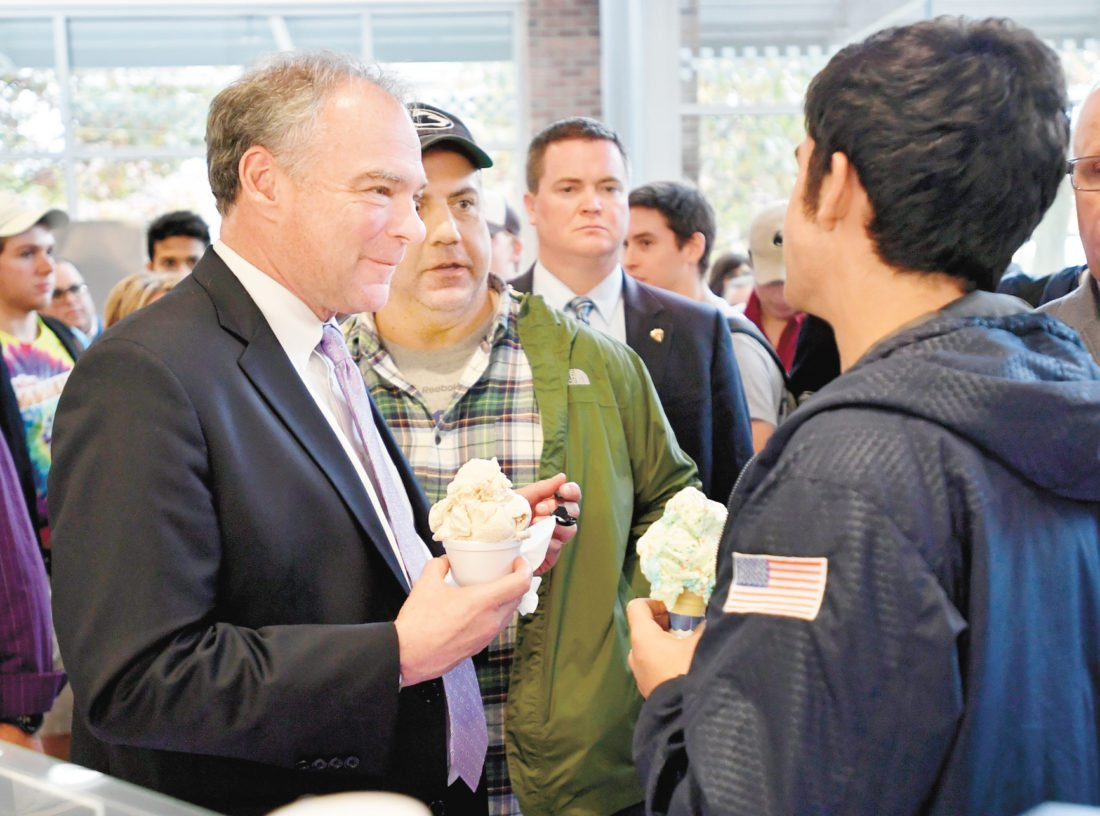 Vice presidential candidate Sen. Tim Kaine talks to visitors at the Penn State Berkey Creamery, Friday, Oct. 21, 2016 in University Park, Pa.  Kaine enjoyed a dish of Autumn Delight. (Abby Drey/Centre Daily Times via AP)