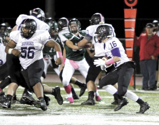 Sentinel photo by ERIKMESSNER Mifflin County's Bryson Phillips (16)carries the ball behind the blocking of Isaiah Reed (56)against West Perry Friday in Elliottsburg.