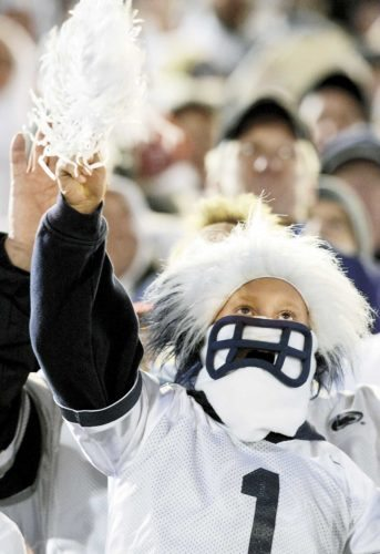 Penn State students celebrate the Nittany Lions' 24-21 upset of Ohio State Saturday evening, at Beaver Stadium.