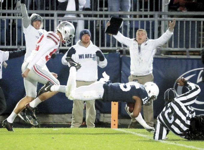 Sentinel photo by CHRISTOPHER SHANNON Penn State's Grant Haley dives into the end zone to score the game-winning touchdown in front of Ohio State's Tyler Durbin after a blocked field goal, fueling the Nittany Lions' 24-21 upset of the Buckeyes Saturday evening at Beaver Stadium.