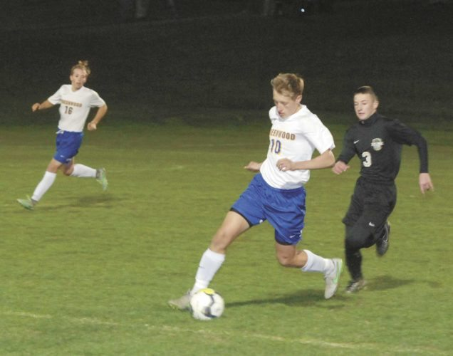 Sentinel photo by BRADLEY KREITZER Greenwood's Josh Kline (10) moves the ball away from Halifax defender Landon Bruner (3) as teammate Chase Stalvey (16) follows the play Monday evening in Millerstown.