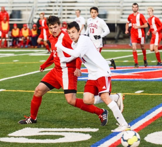 Sentinel photo by TAMI KNOPSNYDER Juniata's Zach Hemond, left, battles Richland's Shane Sloan for the ball in a District 6 Class 2A boys soccer first-round game Tuesday.