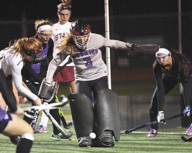 Sentinel photo by STEVE MANUEL Mifflin County goalkeeper Selena Breneman (3) stops a shot on goal by State College's Isabella Messina (left) during Wednesday's  District 6 championship game at Bald Eagle Area. Backing up Breneman are Mifflin County's Camryn Warnick, left, and Amber Schifano.