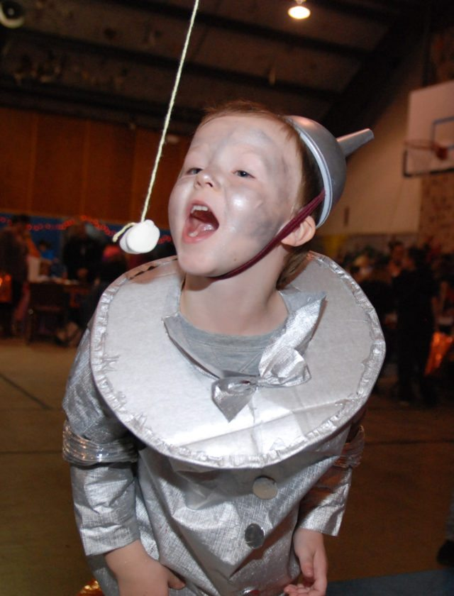 Sentinel photo by BRADLEY KREITZER Caleb Donaldson, 5, of Reedsville, tries to eat a marshmallow without his hands during the Safe Halloween held Thursday evening, at the Juniata YMCA  in Burnham. Twelve merchants and agencies provided games and treats for more than 175 children who attended the event.