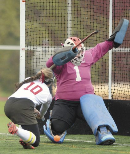 Sentinel photo by STEVE MANUEL Belleville Mennonite's Leah Peachey (10) fires the ball at Forbes Road goalkeeper Zoe Cutchall during Thursday's District 6 title  game in State College. Belleville Mennonite defeated Forbes Road, 3-2.