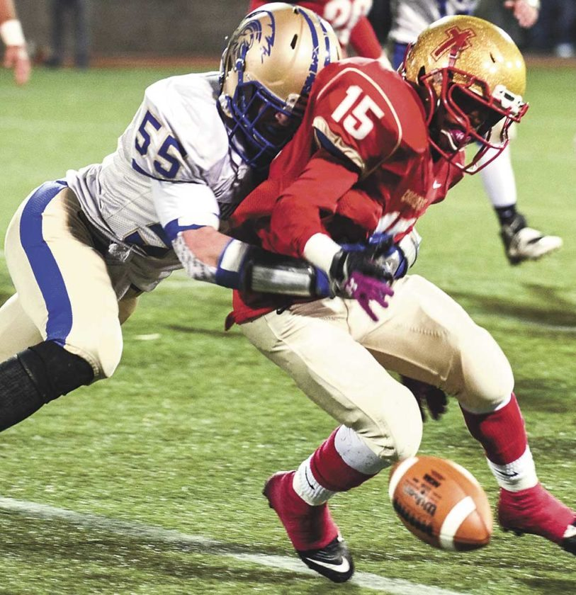 Sentinel photo by TAMIKNOPSNYDER Mount Union's Pat Walker forces Bishop McCort's Imil Britt to fumble in the first half of Saturday's District 6 Class AA quarterfinal at Point Stadium in Johnstown.