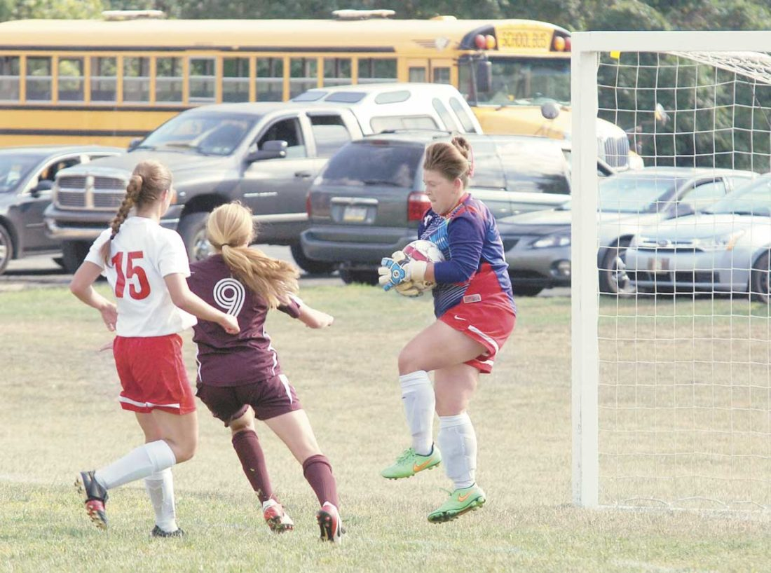 Sentinel file photo Juniata goalie Mahala Laub, right, makes a stop in the Indians' home game against East Juniata this year. Laub will have to work overtime against a potent Hickory offense today.
