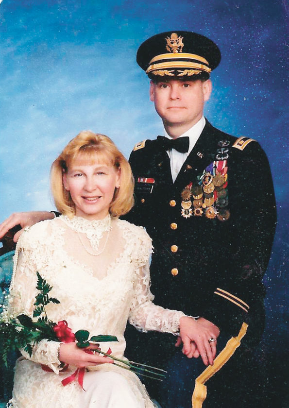 Photos submitted by RUSSELL WALTERS Russell Walters and his wife, Sue Ellen, appear in a portrait commemorating their 25th wedding anniversary. The inset photo shows Walters on his way to helicopter combat assault in III Corps, RVN 1970, with the 62nd Infantry Platoon, 1st Cavalry Division (Airmobile).
