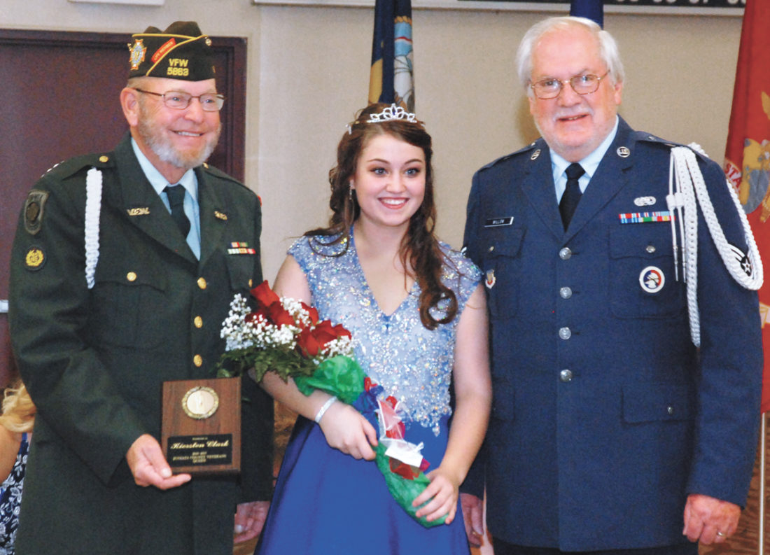 Juniata County Veterans Council members Larry Stone, left, and Garry Willow, right, stand with Kiersten Clark, of Mifflintown, after she was crowned the Juniata County Veterans' Queen, Friday evening in Mifflintown. The winner is determined by the most raffle tickets sold by a contestant. Clark will receive a $2,000 scholarship from the council.  Sentinel photo by BRADLEY KREITZER