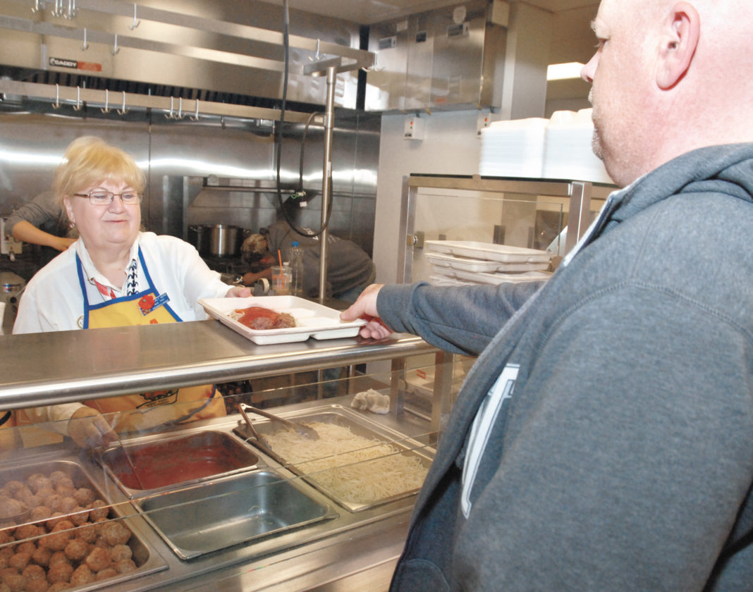 Sentinel photo by BRADLEY KREITZER Beverly Gers, left, of VFW Memorial Post 7011 Auxiliary, serves spaghetti to Desert Storm veteran Michael Priest, of Yeagertown, during a dinner to honor military veterans and emergency responders in Mifflin County on Friday evening at the Lewistown Armory. The event was open, free of charge, to all military veterans, law enforcement, fire fighters and first responders and their spouses. The dinner was hosted by VFW Memorial Post 7011, assisted by members of HHC 2/112 Infantry (Stryker) Bn. and VFW Memorial Post 7011 Auxiliary.