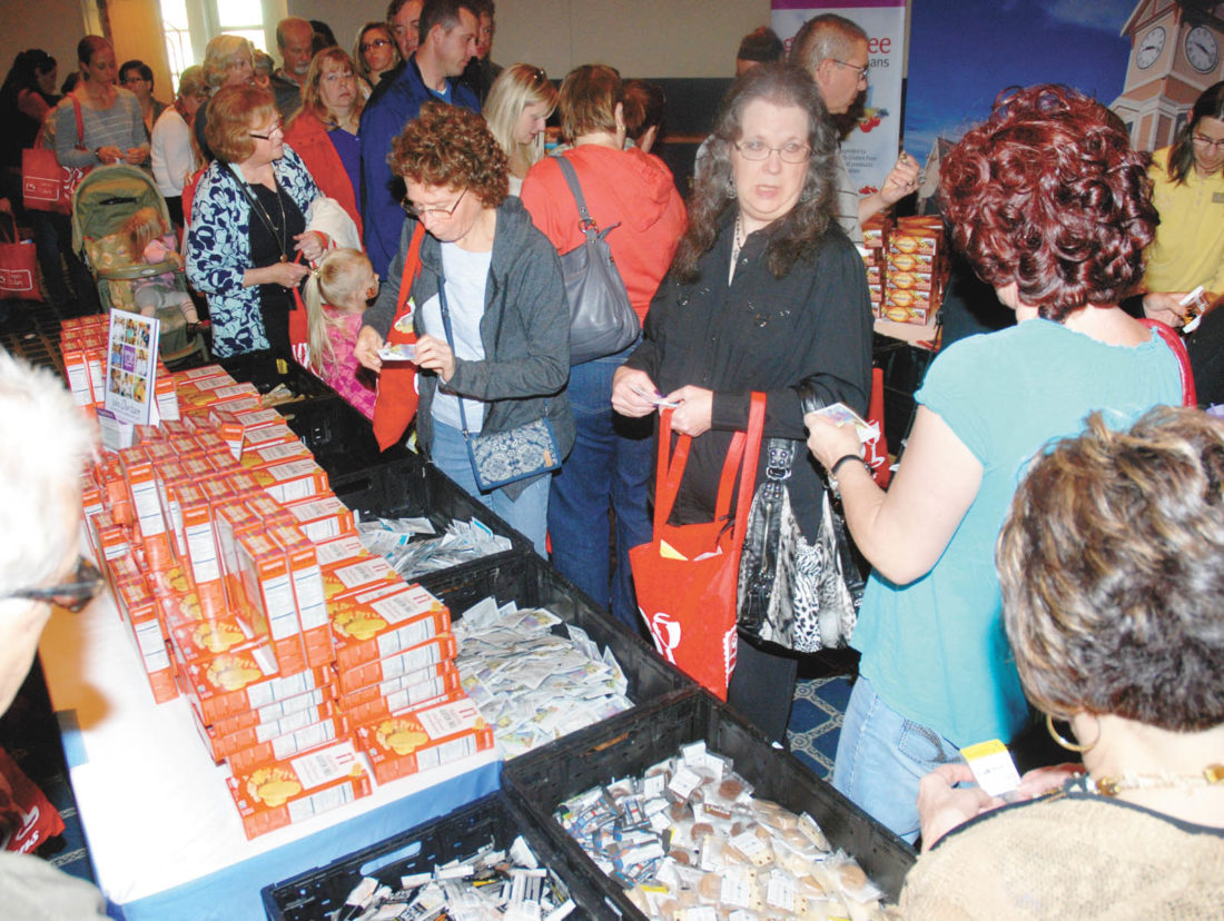 Sentinel file photo Guests at the 2015 Central PA Gluten Free Expo take free samples of food from vendors.